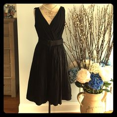 Adorable dress black dress with belt size 12 Stunning little black dress in size 12. Worn once and is right now in excellent condition. Belt can be used for anything other outfit. stretchy material on top with invisible side zipper on the dress. Skirt part is made out of a soft shimmery black material that sparkles. Double lined. Evan Picone Dresses Midi