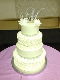 buttercream rosette with bling ribbon www.weddingsbyholiday.com