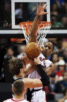 Toronto Raptors' DeMar DeRozan, right, fouls San Antonio Spurs' Tiago Splitter during the first half of an NBA basketball game, Sunday, Nov. 25, 2012, in Toronto. (AP Photo/The Canadian Press, Aaron Vincent Elkaim) (Associated Press) / SA