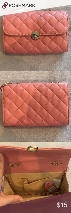 """Pink Vegan Leather Quilted Turnlock Crossbody Bag Brand new with tags. Pink with gold hardware. Turnlock closure. Crossbody strap. Interior with single slot. 7.75"""" x 5"""" x 1.25"""". Please review photos and ask all questions before purchasing. 🛑 No trades! 🛑 WINDSOR Bags Crossbody Bags"""