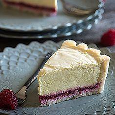 A beautiful raw, gluten free, vegan Meyer lemon tart with a raspberry jam layer.