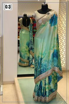 pretty mint and blue theme saree for the festive wear look. For price or detail do whatsApp +91-9913433322