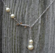 Hey, I found this really awesome Etsy listing at http://www.etsy.com/listing/75234664/rhinestone-leaf-vine-and-ivory-pearls