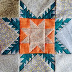 Round Trip Quilts center - Feathered Star. Green Cheese Quilting.