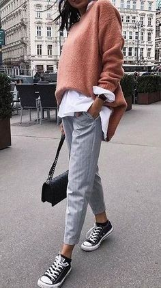 fall street style. tailored trousers. white shirt. knit jumper. sneakers.
