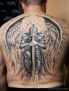 Angel And Sword Tattoo On Back                                                                                                                                                     Más