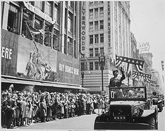 In parade for Generals Patton and Doolittle in Los Angeles, General George S. Patton acknowledges the cheers of the welcoming crowds, 9 Jun 1945. (US National Archives)
