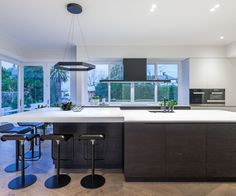 Black accents and design perfect for entertaining give this villa kitchen a modern feel