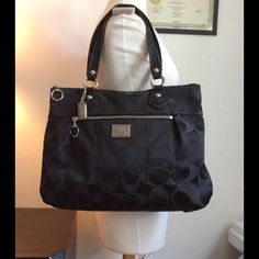 """Authentic Coach Black Poppy large bag  Like new!!! Authentic Coach Poppy bag, with serial number, black signature C fabric, fuchsia and clean inside, black straps, silver metals. Great condition, clean, no flaws, like new. 13"""" X 17 1/2"""" X 3"""" Large bag.  -No holds.  -No trades. -No more discounts for this bag, It is not easy to find good prices for reselling, do not ask for lower prices Please.  Click the listings to see the boutique  Thanks for your visit Coach Bags Totes"""