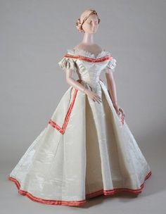 """Ca.1865 evening dress. Moire silk trimmed with bands of """"pink"""" satin and seed pearls ringed with crystal beads. There are both dinner and ball bodies. Kent State Museum."""