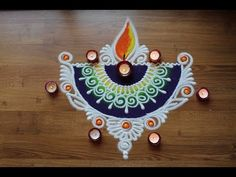 This is a special Diya rangoli design for Diwali. I have created a semicircular Diya bottom and decorated that with the Sanskar Bharti designs and placed som. Easy Rangoli Designs Diwali, Indian Rangoli Designs, Simple Rangoli Designs Images, Rangoli Designs Latest, Rangoli Designs Flower, Free Hand Rangoli Design, Rangoli Border Designs, Small Rangoli Design, Rangoli Ideas