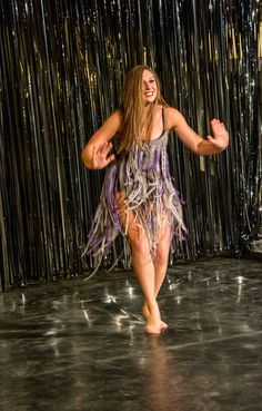 Stella Taylor busts a move during the Arts Bash Fashion show on January 31, 2015