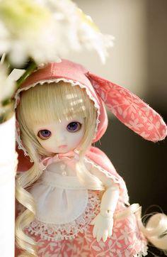 So sweet, love her bunny hat