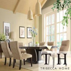 This Charles dining Set features an elegant oblong table of espresso finished ash, surrounded by luxuriously padded chairs upholstered in a creamy chenille fabric. A butterfly extension leaf makes extra room for a table centerpiece or a holiday feast.