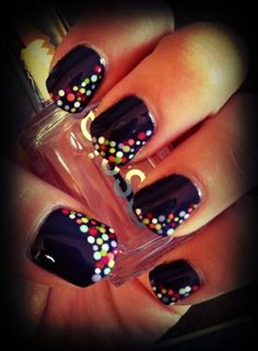 Multi-color dots on black nail design