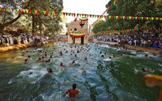 Ethiopian Orthodox pilgrims bathe during a ceremony at the Fasilides baths as part of the Timkat festival in Gondar. Timkat is the Ethiopian Orthodox Christian festival which celebrates the baptism of Jesus in the Jordan river.  (Carl De Souza)
