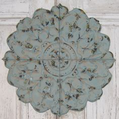An irresistibly pleasing wall accent, our rosette metal wall plaque has an appeal that blends well with Old World decor.  Sporting graceful swirls, leaves, and flowers, this delightful piece will brea...