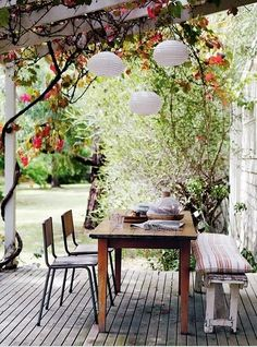 Patio with a vintage bench and industrial chairs, love the mix and match