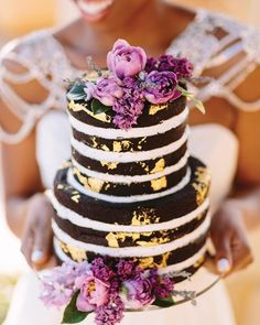 Something different - a chocolate naked cake - beautifully decorated with purple blooms ~ Munaluchi Bridal Magazine