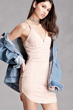 A faux suede slip dress featuring a V-neckline, crisscross cami straps, padded cups, and a dolphin hem. This is an independent brand and not a Forever 21 branded item.