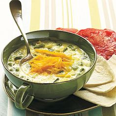 ---Spicy Poblano and Corn Soup--- 1 (16-ounce) package frozen baby gold and white corn (such as Birds Eye), thawed and divided 2 cups fat-free milk, divided $ 4 poblano chiles, seeded and chopped (about 1 pound) 1 cup refrigerated prechopped onion $ 1 tablespoon water 3/4 teaspoon salt 1/2 cup (2 ounces) reduced-fat shredded sharp cheddar cheese