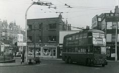 The penultimate picture in this shot sees a trolleybus on route 609 again, making the turn from Essex Road into Upper Street in order to get back on route. The usual destination for this route was Barnet, but this bus is only going as far as Archway. The buildings behind the bus have gone, but those on the far left remain - see next and last pic in this set.  Photo - Fred Ivey  N.B This picture is part of a set looking at the Angel, Islington, travelling from Rosebery Avenue to Islington… London Bus, Old London, East London, Essex Road, London History, Barnet, London Transport, My Heritage, Taxi