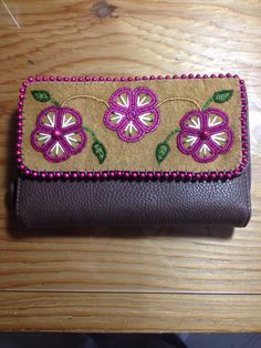 Beaded wallet cover on smoked moose leather with pink flowers and porcupine quills by Alaska Beadwork.