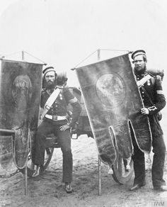 Crimean War: Company Sergeant William Christie and Sergeant Samuel McGifford, Bn., Royal Artillery, with captured Russian banners which were brought back to England as war trophies, © IWM (Q Military Tactics, Military Art, Military History, Military Uniforms, Military Flags, Military Chic, British Army Uniform, British Soldier, Uk History