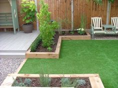 Lawn, sleepers, patio in garden.