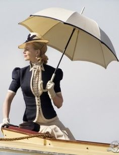 """""""At the beginning, she's an uptight aristocrat—tailored and done-up,"""" says Catherine Martin of Lady Sarah, whose outfits draw inspiration from the sportswear of the '30s. Martin says she created the looks from Baz Luhrman's vision, combined with research of the period. """"We looked at women of Sarah's class and nationality and the designers of that period and then went to Nicole's home in Nashville and did a costume workshop 18 months before shooting,"""" says Martin of the process."""