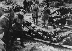 At the Klooga concentration camp, Soviet soldiers examine the bodies of victims left by the retreating Germans. Klooga, Estonia, September 1944.
