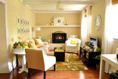 I love the creamy, warm, lightly and cozy John and Sherry den's. A perfect balance between white chairs and sofa and black otomanas and tv stand. Even the color pops of green and yellow gives a great summer vibe.