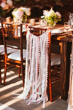 boho wedding chair decor via Studio Finch Photography - Deer Pearl Flowers / http://www.deerpearlflowers.com/reception-decor/boho-wedding-chair-decor-via-studio-finch-photography/