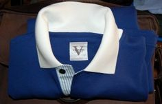 Vastrm, custom polo shirts - solid blue, white flat knit collar, striped placke accent, black buttons