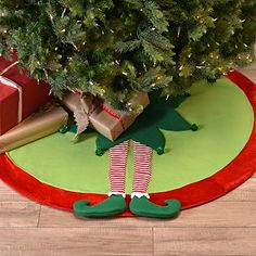 Bring a whimsical touch to your tree with our Standing Elf Leg Tree Skirt! Featuring two elf legs and a red rim, it will fit perfectly with your holiday decor! This tree skirt measures in diameter **These tree skirts will only be sold until December Elf Christmas Tree, Snowman Tree, Crochet Christmas Trees, Purple Christmas, Felt Christmas, Christmas Colors, Christmas Crafts, Christmas Ornaments, Christmas Morning