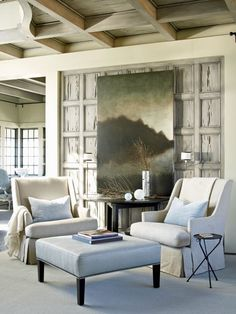 Pretty living room. Love the wooden boxed frame behind the artwork.