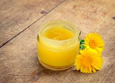 Commonly called the pot marigold, calendula has been used for centuries as a healing oil, tonic and so much more. If you're growing calendula in your backyard, but don't know how to harness its fantastic powers, why not whip up a batch of nourishing calen Huile Anti Ride, Organic Skin Care, Natural Skin Care, Coconut Oil Moisturizer, Le Psoriasis, Salve Recipes, Calendula Oil, Healing Oils, Body Butter