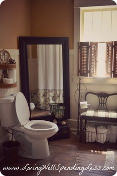 Love this bathroom decor! The mirror in corner is awesome! large mirror against wall to open up our small bathroom is a great idea