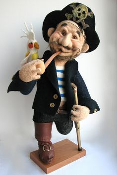 Needle felted pirate doll by Sirychok.