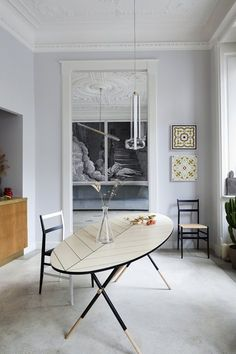 Interior designer Pietro Russo preserved the architectural embellishments of this Art Nouveau Milan apartment, but introduced furnishings — like this dining table of his own design — to introduce a more contemporary sensibility. Estilo Interior, Interior Styling, Interior Decorating, Decorating Ideas, Casa Milano, Muebles Art Deco, Interior Design Minimalist, Dining Room Design, Dining Rooms