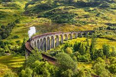 "Glenfinnan Railway Viaduct in Scotland - Glenfinnan Railway Viaduct in Scotland with the Jacobite steam train passing over   Thank you for visiting.  If you like my work, join my facebook page <a href=""https://www.facebook.com/nicksimages"">www.facebook.com/nicksimages</a>  For purchases use  <a href=""http://www.nicksimages.com"">my photography website</a>"