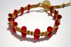 Knotted bracelet red crystals on gold waxed linen Add a little gold glamour Boho style to your arm with this beautiful combination of red faceted crystals on bright gold macrame waxed linen.