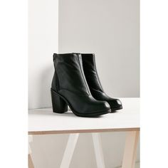 Jeffrey Campbell Arundel Boot ($190) ❤ liked on Polyvore featuring shoes, boots, black, black bootie, genuine leather boots, black leather shoes, zip ankle boots and short black boots