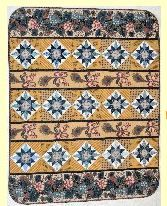 """PA Mustard - Pattern $10.00  Quilt Size: 42.5"""" x 53.5""""   Block size: 6""""  Looking at Pennsylvania side road landscapes, you find blue corn flowers and golden mustard plant blooming side by side. William Penn must have seen the same colorful roadside sight. The mustard plant was an historical source of dye for ancestors. This quilt boasts a border print fabric from the State Museum of Pennsylvania, c. 1820. Find your favorite border print fabric and make it fit!"""
