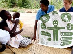 """The Information Blanket - Buy One, Give One //  With every English language version of the information blanket you purchase,  another one is given to a mother and her baby in need somewhere else in the world, starting with Uganda. There is also a Give One donation option. The information is specific to the region and is presented along with an orientation. Blankets are made in USA from 100% pre-shrunk North Carolina eco-cotton. Dimensions: 23"""" x 32"""" (swaddling size)."""