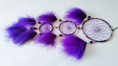 3 Tiered Dream Catcher - handmade with wool yarn, cording, metal charms, glass beads and purple marabou feathers. Hoops are 4, 3, 2.5 inch. You can see all my designs at https://www.facebook.com/pages/Dreamscape/471890606282556