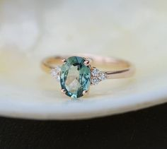 Just the center stone on a pavé band | Engagement Ring Rose gold engagement ring Green Blue Sapphire ring Blake Lively ring oval cut Rose gold diamond ring 1.3ct sapphire ring by EidelPrecious on Etsy