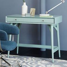 West Elm's Mid-Century Mini-Desk in Oregano. During my initial frenzy I bought this huge mint vintage Steelcase desk that is ALL wrong for the space. Since I need somewhere to study (and possibly double as a vanity), something like this really calls to the bright/playful side of the space.