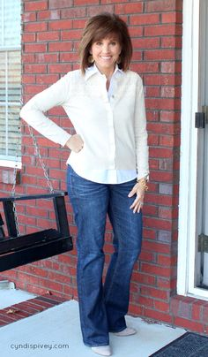 Tan cardigan with lace details/White collared blouse/gold Earrings/Gold Chain Bracelet/Boot cut jeans/Tan booties