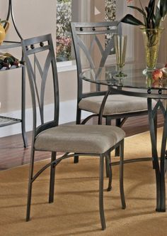 """Steve Silver Madrid Welded Side Chair (Set of 4) by Steve Silver. $256.00. Welded 1 pc. Frame. Sturdy gauge metal. Contemporary Style. Metal Base/Microfiber Cushion. 18"""" Seat Height. For distinctive styling select our Madrid side chairs. Double split curve legs and a durable beige seat cushion are perfect in any dining decor. What's included: Side Chair (1)."""